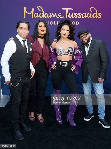 Selena's husband Chris Perez sister Suzette Quintanilla and brother AB Quintanilla onstage during Madame Tussauds Hollywood's unveiling of GRAMMY...