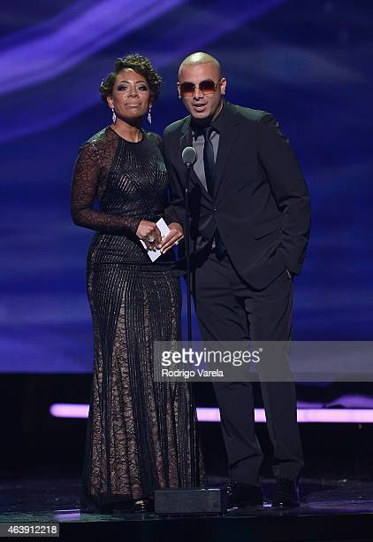 Selenis Leyva and Wisin speak onstage at the 2015 Premios Lo Nuestros Awards at American Airlines Arena on February 19 2015 in Miami Florida