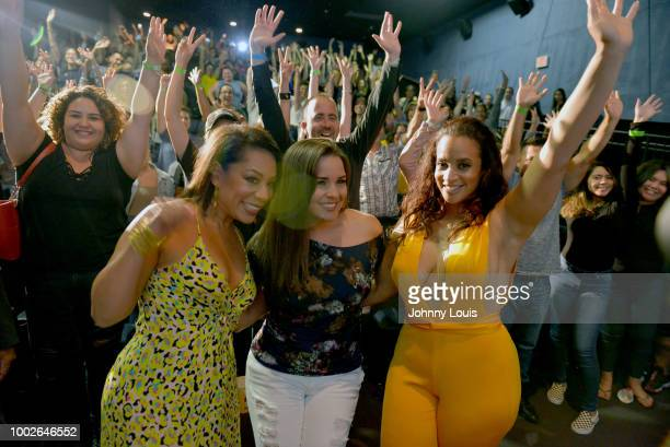 Selenis Leyva Dascha Polanco and host Gigi Diaz pose for a picture with fans after the 'Orange Is The New Black' Netflix TV show screening and QA at...
