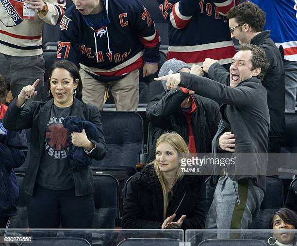 Selenis Leyva Philipa Coan and Jude Law are seen at Madison Square Garden on December 18 2016 in New York City