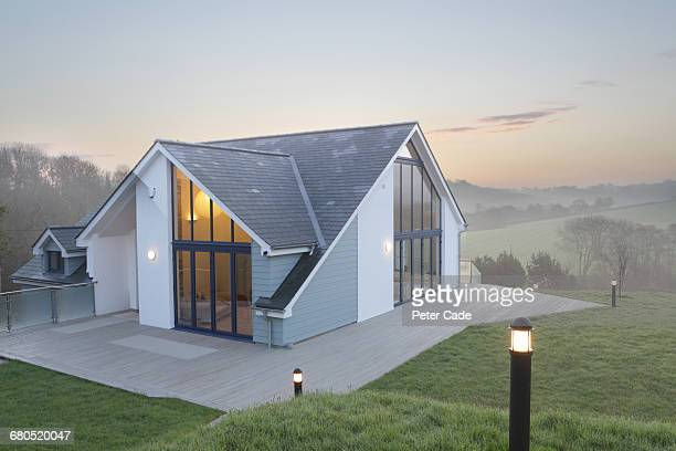 self build country home, morning mist - building exterior stock pictures, royalty-free photos & images