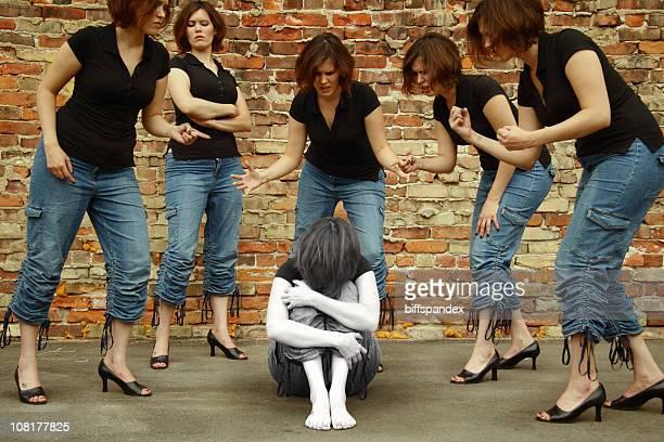 Self- Bullied Woman Cowers Amongst Dopplegangers
