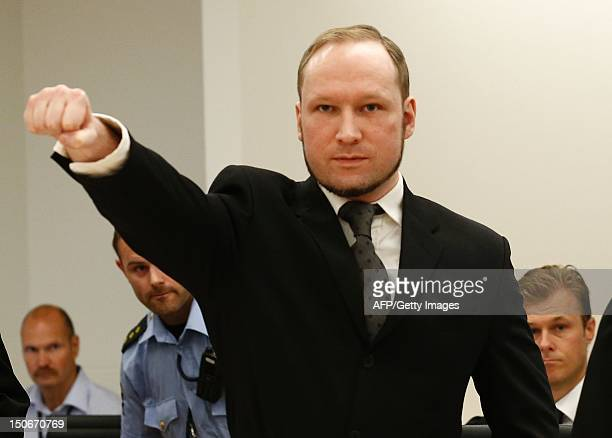 Self confessed mass murderer Anders Behring Breivik raises his fist in a right wing salute on arrival court room 250 at Oslo central court on August...