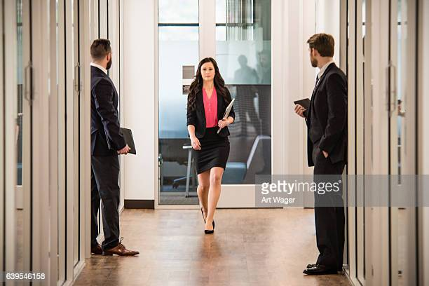 self confident businesswoman walking through the office - up skirt stock photos and pictures