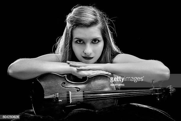 Self confident young woman posing with her violin