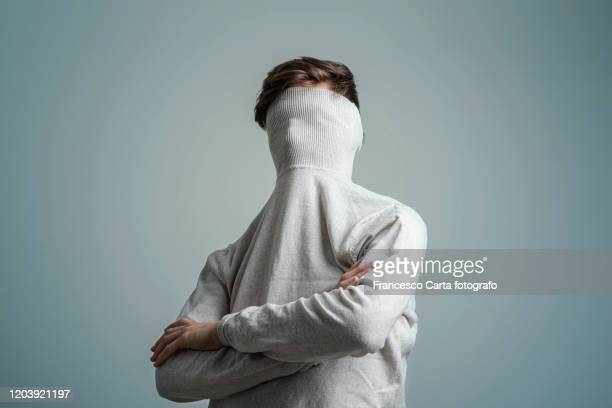 self consciousness - obscured face stock pictures, royalty-free photos & images