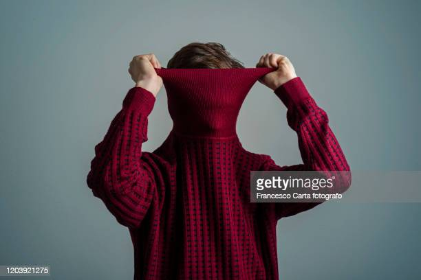 self consciousness - red shirt stock pictures, royalty-free photos & images