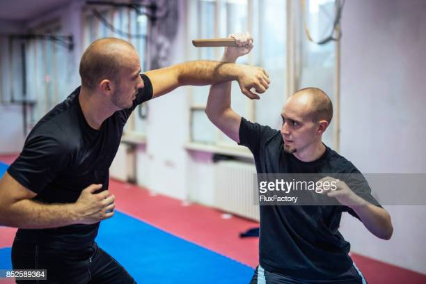 self - defence - defending stock pictures, royalty-free photos & images