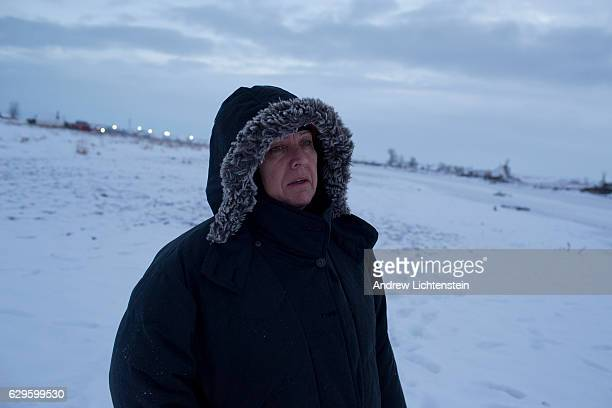 """Self described """"water protector"""" watches the dawn come up over the Cannonball River Just outside of the Lakota Sioux reservation of Standing Rock,..."""
