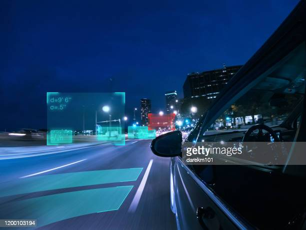 self driving autonomous car driving in the city, usa - autonomous technology stock pictures, royalty-free photos & images