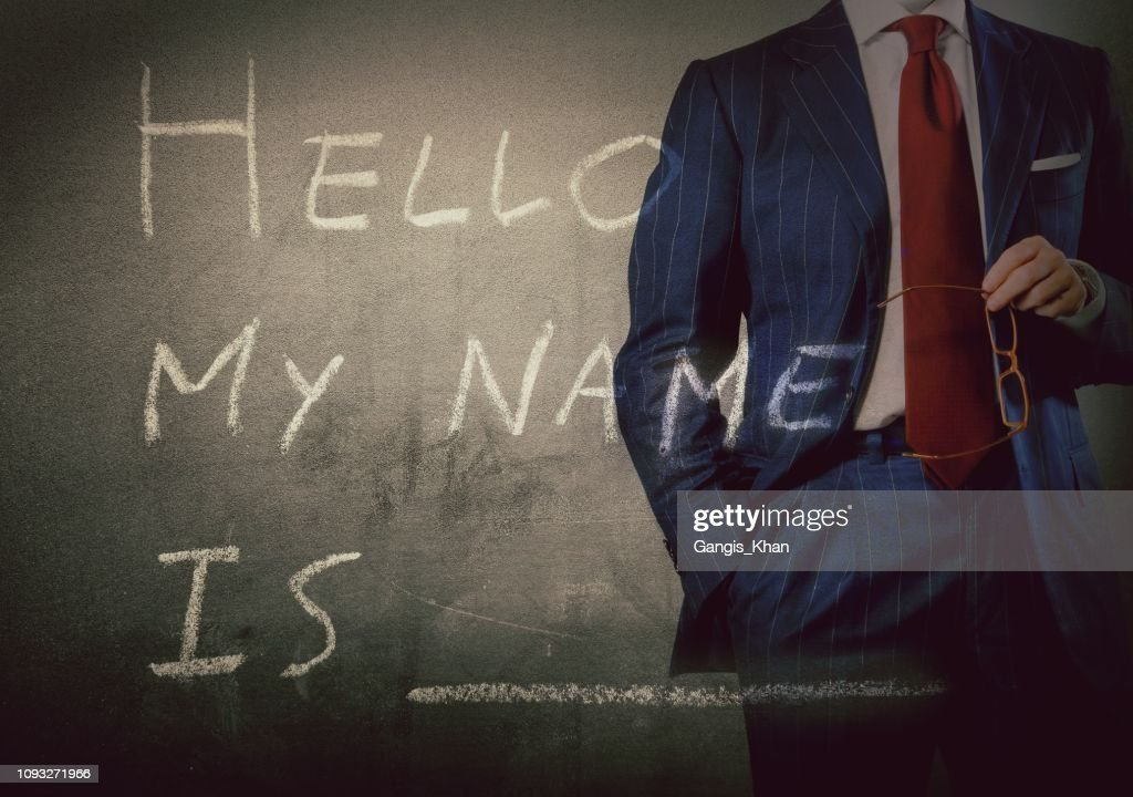 Self Introduction - Hello, My name is ... written on a blackboard with businessman : Stock Photo