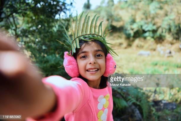 self portrait of a girl wearing fern crown - モバイル撮影 ストックフォトと画像