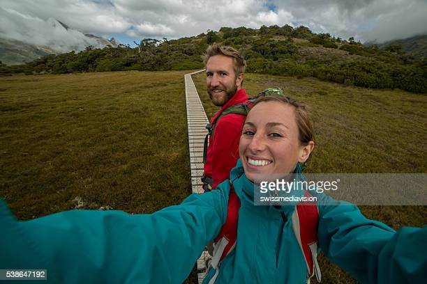 Self portrait of a young couple hiking