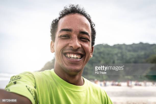 self portrait of brazilian men at the beach - brazilian men stock photos and pictures
