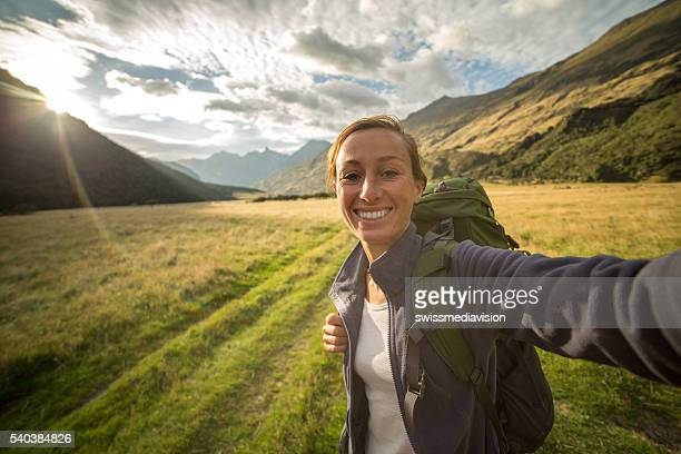 Self portrait of female hiking in the valley at sunrise