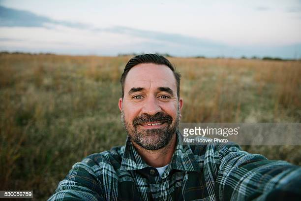 self portrait of smiling farmer in field, plattsburg, missouri, usa - self portrait stock pictures, royalty-free photos & images