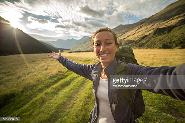 Self portrait of woman hiking in the valley at sunrise