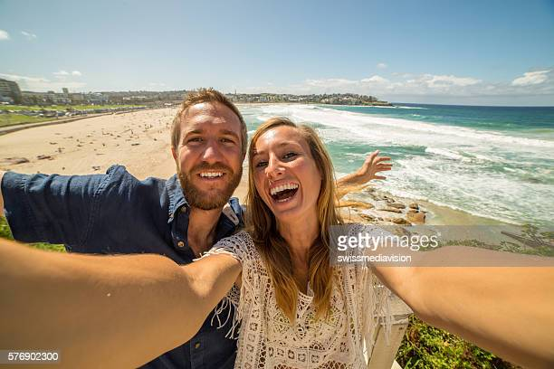 Self portrait of young couple at bondi beach, Australia