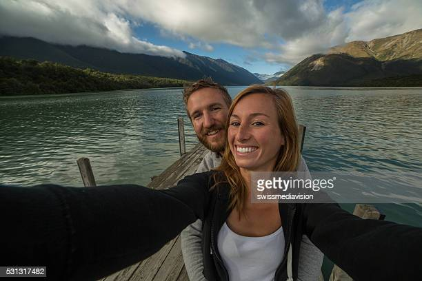 Self portrait of young couple capturing vacation moments