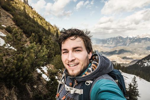 Self portrait of young man in mountains, Hundsarschjoch, Vils, Bavaria, Germany - gettyimageskorea