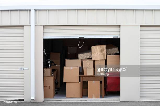 self storage warehouse building with an open unit. - storage compartment stock pictures, royalty-free photos & images