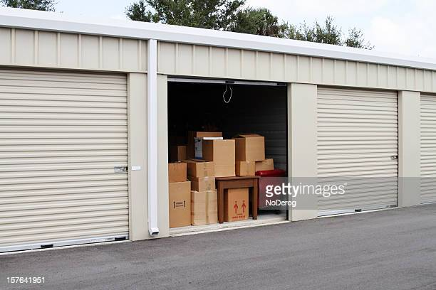 self storage warehouse with single storage unit open to - storage compartment stock pictures, royalty-free photos & images