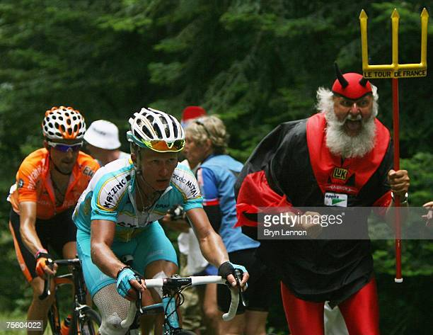 Self-appointed 'Devil of the Tour de France' Didi Senft gives Alexandre Vinokourov of Germany and Astanasome encouragement during stage 15 of the...