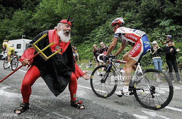 """Self-appointed """"Devil of the Tour de France"""" Didi Senft offers Christian Moreni of Italy and Cofidis some encouragement during stage 10 of the 93rd..."""
