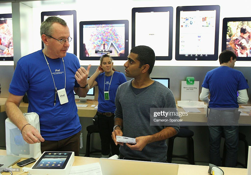 Self-confessed Apple fanatic Rahul Koduri opens the first purchased iPad in Australia at the Apple store on George Street on May 28, 2010 in Sydney, Australia. Apple's new tablet media device went on sale in nine countries around the world today following its launch in the United States in April this year.