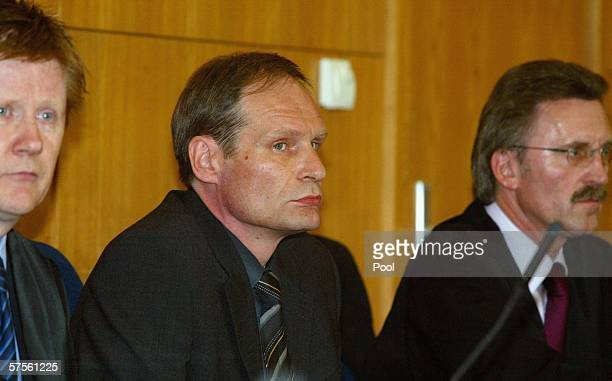 Selfconfessed cannibal Armin Meiwes awaits the verdict in his retrial for murder between his lawyers Harald Ermel and Joachim Bremer on 09 May 2006...