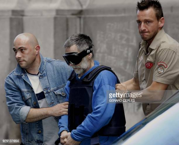 Selfconfessed French serial killer Michel Fourniret arrives for a hearing at police headquarters in Dinant 08 July 2004 Fourniret has admitted to the...