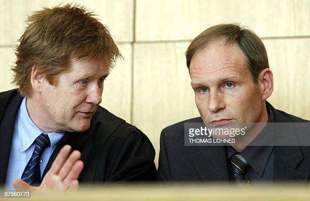 Selfconfessed German cannibal Armin Meiwes listens to his advocate Harald Ermel as he waits for the beginning of a session of his retrial 09 May 2006...