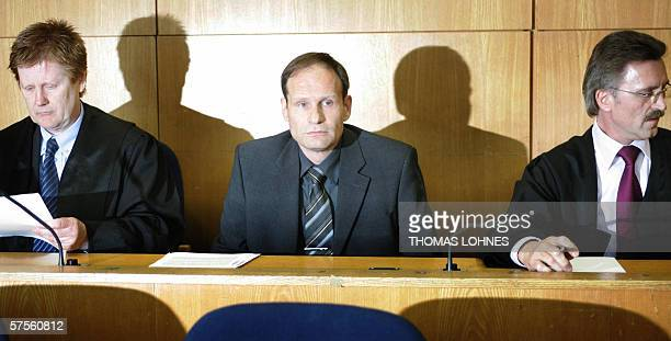 Selfconfessed German cannibal Armin Meiwes sits between his advocates Harald Ermel and Joachim Bremer as he waits for the beginning of a session of...