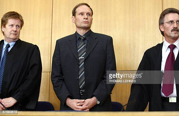 Selfconfessed German cannibal Armin Meiwes stands between his advocates Harald Ermel and Joachim Bremer as he waits for the beginning of a session of...