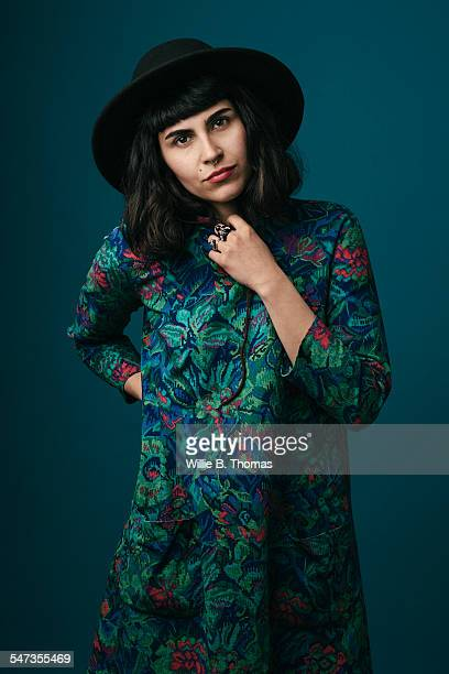 self-confidence middle eastern woman - multi colored hat stock pictures, royalty-free photos & images