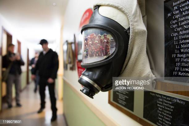 A selfcontained breathing apparatus and a photo of recruits is pictured on a plaque inside a Washington State Patrol Fire Training Academy dormitory...