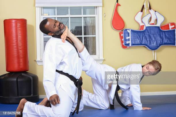self-defense connection - gerville stock pictures, royalty-free photos & images
