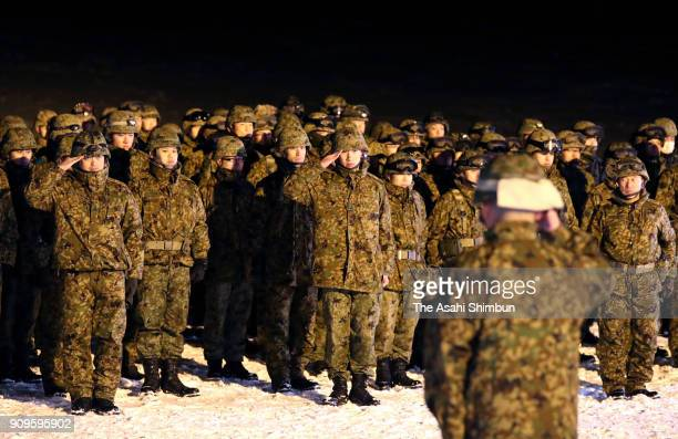 SelfDefense Force members salute after a searching operaton on January 23 2018 in Kusatsu Gunma Japan KusatsuShirane a 2160meter volcano erupted in...