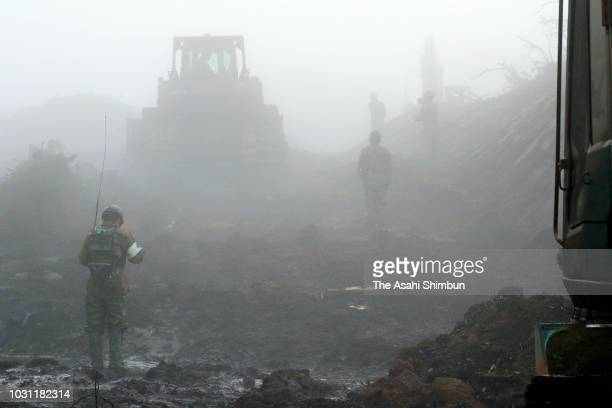 SelfDefense Force members work amid heavy fog on September 11 2018 in Atsuma Hokkaido Japan A male resident in Atsuma who was the last reported...