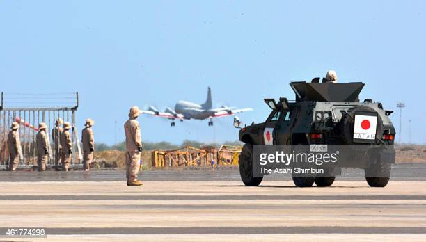 A SelfDefense Force P3C maritime surveillance aircraft and light armored vehicle stationed at the SDF antipiracy base on January 18 2015 in Djibouti...