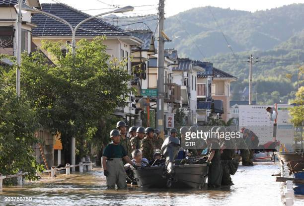 SelfDefense Forces personnels rescue people by boats from Mabi Memorial Hospital that was isolated due to flood damage caused by heavy rain in...