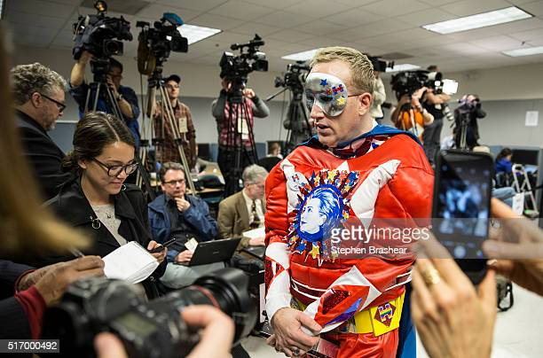 Selfdescribed supervolunteer Clinton Jessee also known as Captain Hillster speaks with reporters at a labor rally for Democratic presidential...