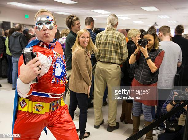 Selfdescribed supervolunteer Clinton Jessee also known as Captain Hillster poses for photos at a labor rally for Democratic presidential candidate...
