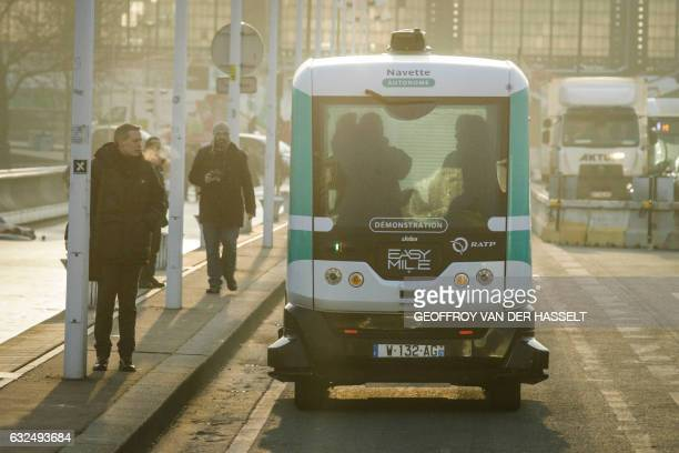 A selfdriving bus shuttles between Austerlitz station and Lyon station in Paris produced by Easymile company in Paris on January 23 2017 The RATP...