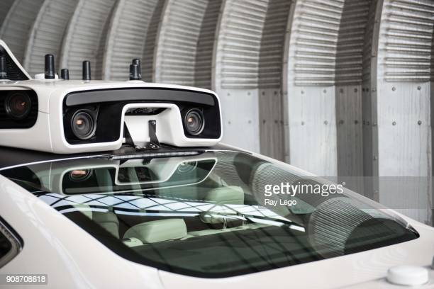 Self-Driving car in Industrial area of Pittsburg on September 2016, Laser scanners on top of car build a 3d map of the streets.