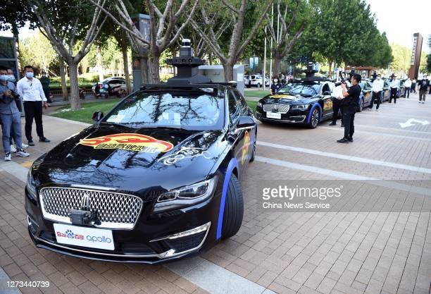 Self-driving cars under development by Chinese internet search giant Baidu Inc. Are on display during 2020 Zhongguancun Forum on September 19, 2020...