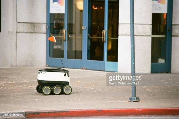 Selfdriving delivery robot from startup Starship Technologies drives past the Lesher Center in downtown Walnut Creek California as it makes an...