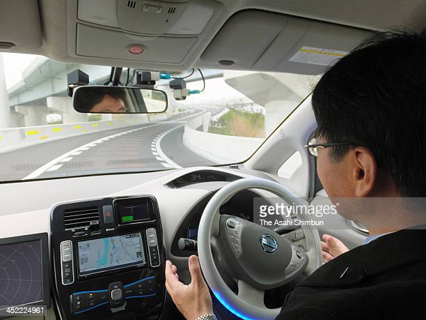 A selfdriving Nissan Leaf makes an automatic lane change on the Sagami Expressway after the driver switched on a turn signal during a test run on...