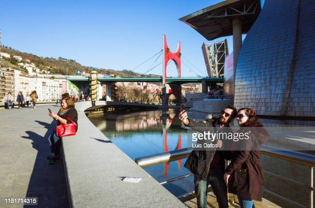 selfie by the guggenheim - dafos stock photos and pictures