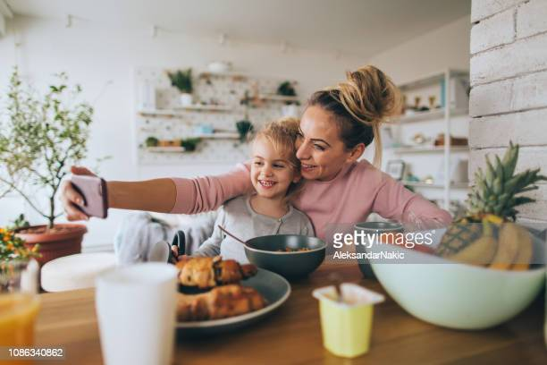 selfie during a breakfast - mother's day stock pictures, royalty-free photos & images